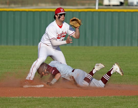 Bowie's Evan Kennedy steals second under Holliday's Jake Turner Tuesday, March 26, 2019, in Holliday.