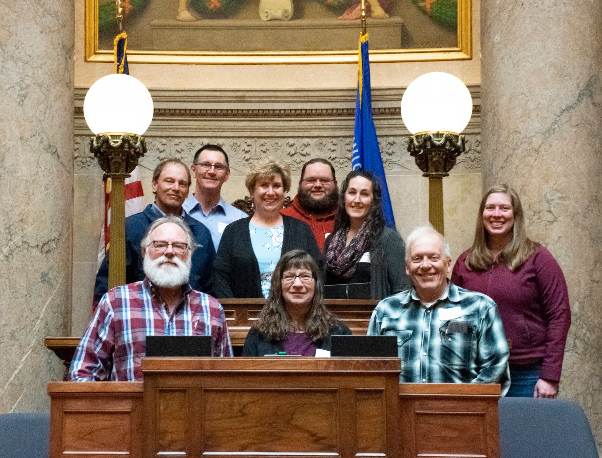 Farmers and agriculturists from the Madison area talked with legislators while visiting the Capitol.