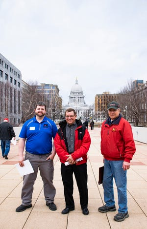 Sawyer County Farm Bureau members (from left) Andrew Winiarczyk, Dale Beissel and Mike Robers stopped for a photo outside the Capitol.