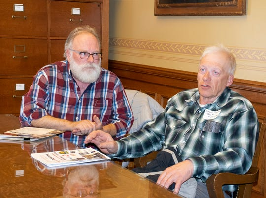 Monroe County Farm Bureau members Tony Bowers (left) and Jack Herricks spoke with their legislators about the state budget proposal and the challenges of the current farm economy.