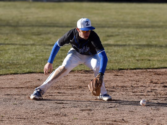 Freshman shortstop Avery Parmer fields a ground ball during Zanesville's 13-2 loss to Lakewood on Tuesday at Jay Payton Field.