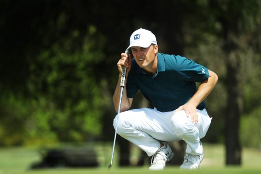 Jordan Spieth lines up a putt on the first green in his match against Billy Horschel during the first round of the World Golf Championships-Dell Match Play.