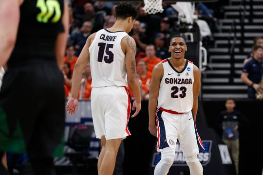 Gonzaga forward Brandon Clarke (15) and guard Zach Norvell Jr. (23) celebrate the team's win over Baylor in a second-round game in the NCAA men's college basketball tournament Saturday, March 23, 2019, in Salt Lake City. (AP Photo/Jeff Swinger) ORG XMIT: UTJS114