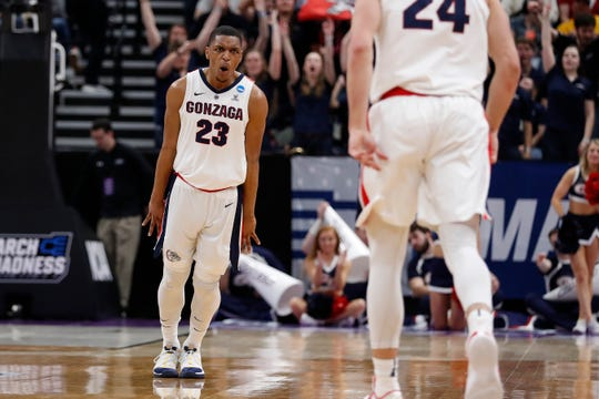 Gonzaga guard Zach Norvell Jr. (23) reacts after a 3-pointer by Gonzaga forward Corey Kispert (24) against Fairleigh Dickinson in the first half during a first round men's college basketball game in the NCAA Tournament Thursday, March 21, 2019, in Salt Lake City. (AP Photo/Jeff Swinger) ORG XMIT: OTKUTJS200