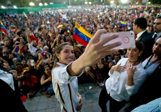 Fabiana Rosales, wife of Venezuela's self-proclaimed interim president Juan Guaido, takes a selfie with Venezuelans living in Chile on March 20.