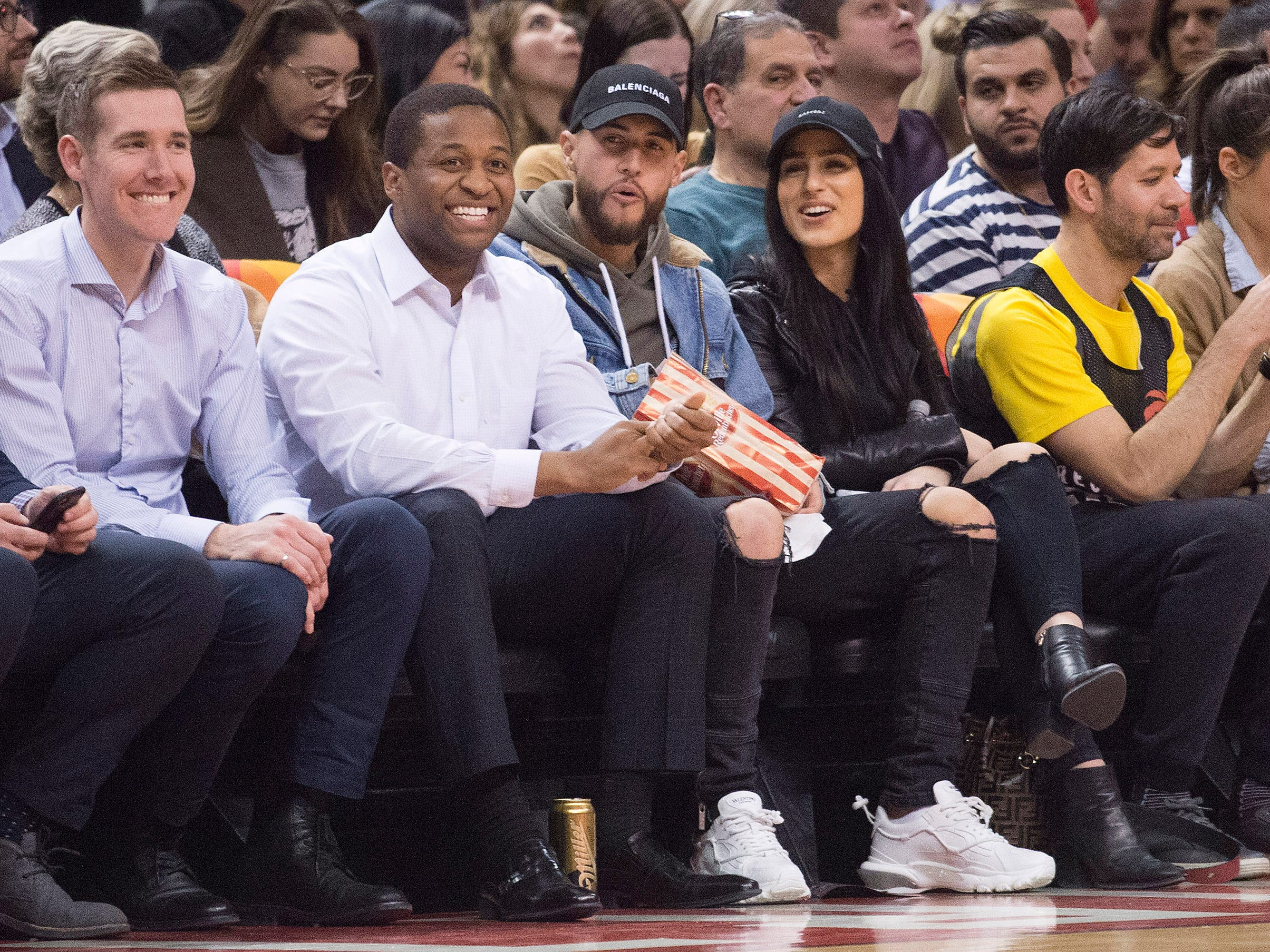 March 26: Toronto FC player Jonathan Osorio (middle) watches a game during the fourth quarter between the Chicago Bulls and the Toronto Raptors at Scotiabank Arena.