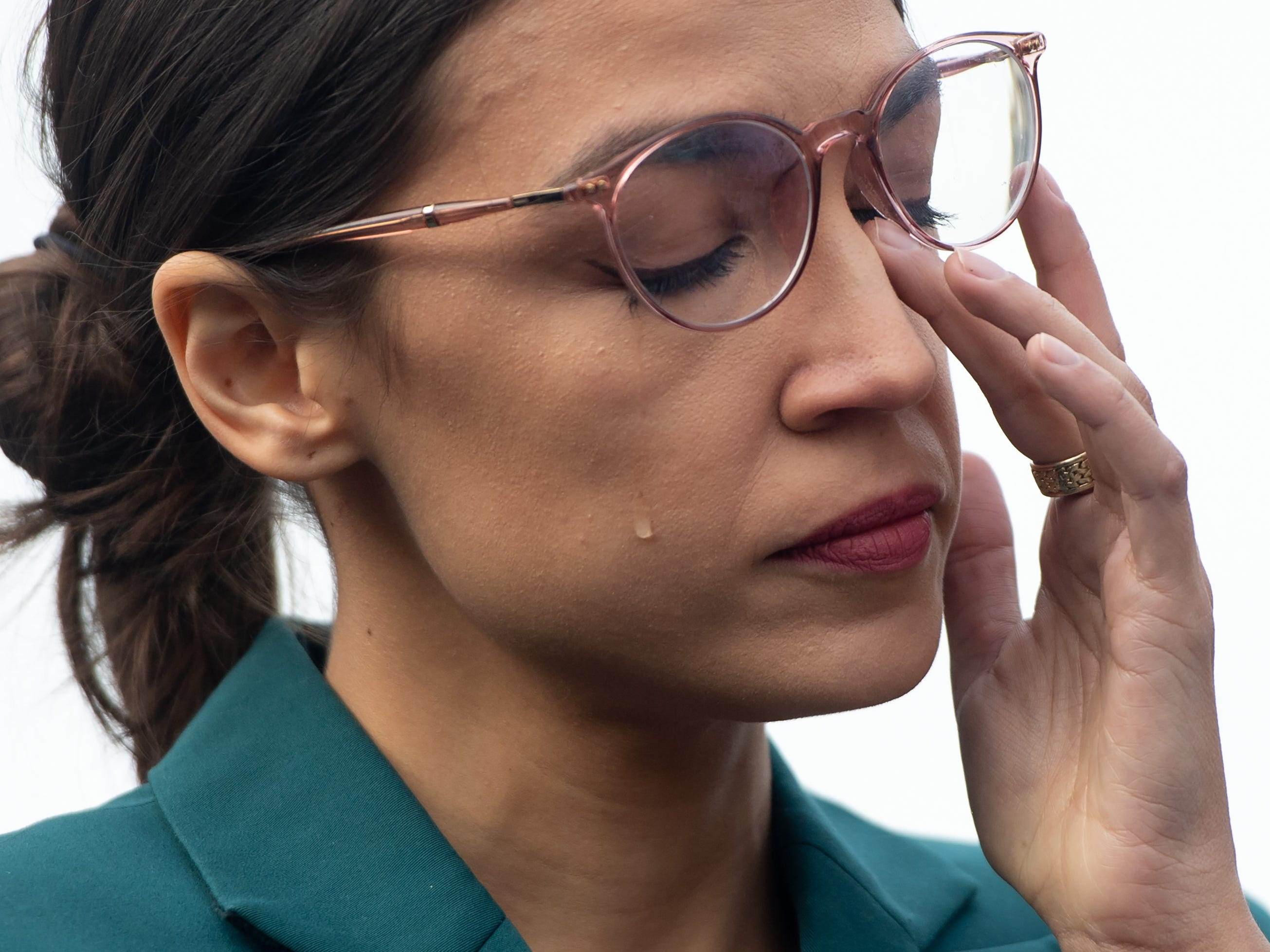 US Representative Alexandria Ocasio-Cortez, Democrat of New York, sheds a tear during a press conference calling on Congress to cut funding for US Immigration and Customs Enforcement (ICE) and to defund border detention facilities, outside the US Capitol in Washington, DC, February 7, 2019. (Photo by SAUL LOEB / AFP)SAUL LOEB/AFP/Getty Images ORIG FILE ID: AFP_1D55JR