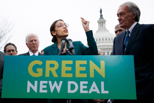 epaselect epa07351016 Democratic Representative from New York Alexandria Ocasio-Cortez (L), with US Democratic Senator from Massachusetts Ed Markey (R), delivers remarks on the 'Green New Deal' resolution during a press conference on Capitol Hill in Washington, DC, USA, 07 February 2019. The resolution emphasizes massive public investment in wind and solar production, zero-emission vehicles and high-speed rail, energy-efficient buildings, and smart power grids, as well as 'working collaboratively' with farmers and ranchers to move towards sustainable agriculture techniques.  EPA-EFE/SHAWN THEW ORG XMIT: STX17