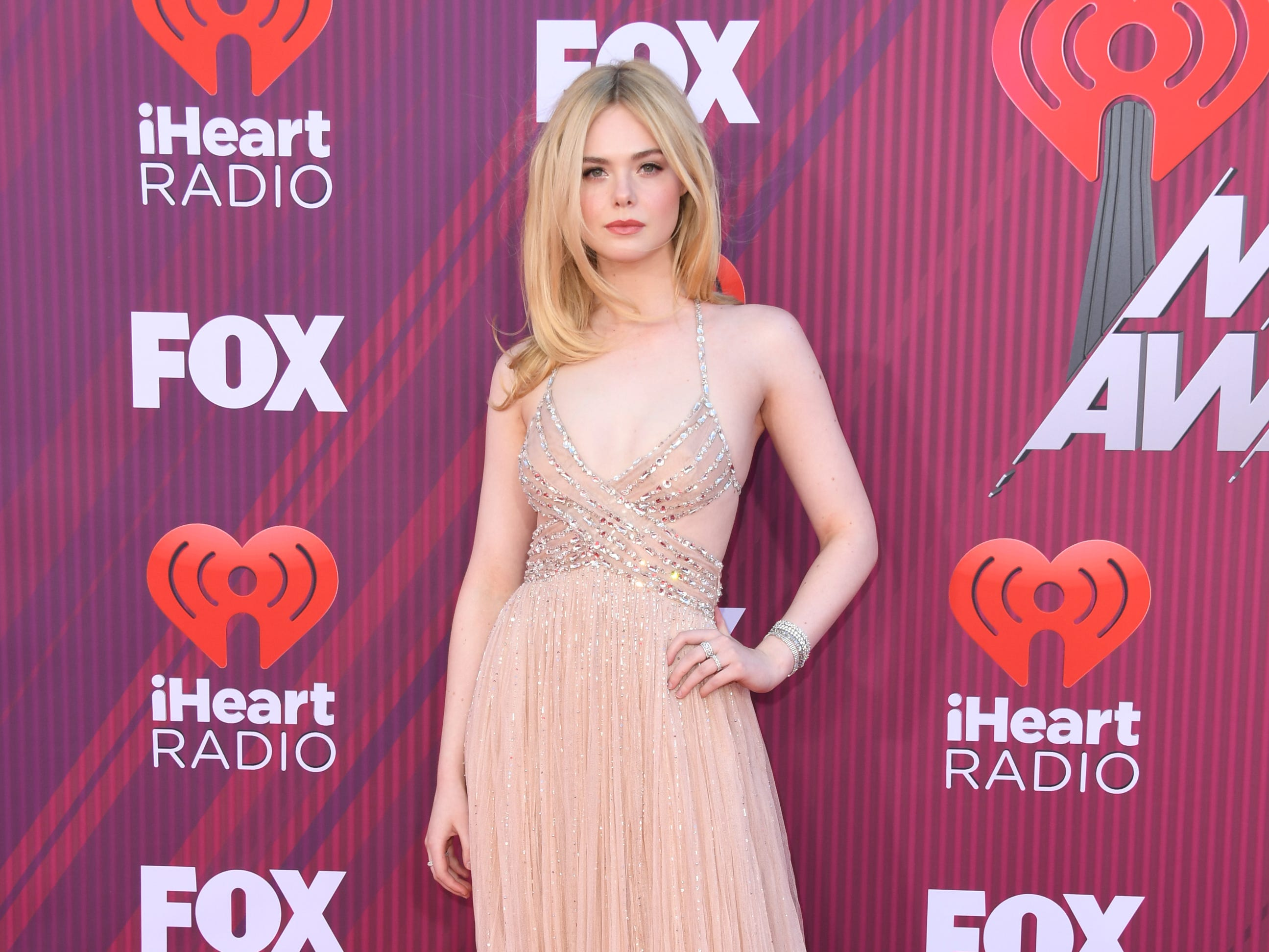LOS ANGELES, CALIFORNIA - MARCH 14: Elle Fanning attends the 2019 iHeartRadio Music Awards which broadcasted live on FOX at Microsoft Theater on March 14, 2019 in Los Angeles, California. (Photo by Jon Kopaloff/FilmMagic) ORG XMIT: 775279819 ORIG FILE ID: 1135883039