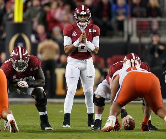 Alabama quarterback Jalen Hurts stands at the line of scrimmage during the second half in the College Football Playoff championship game on Jan. 7, 2019.