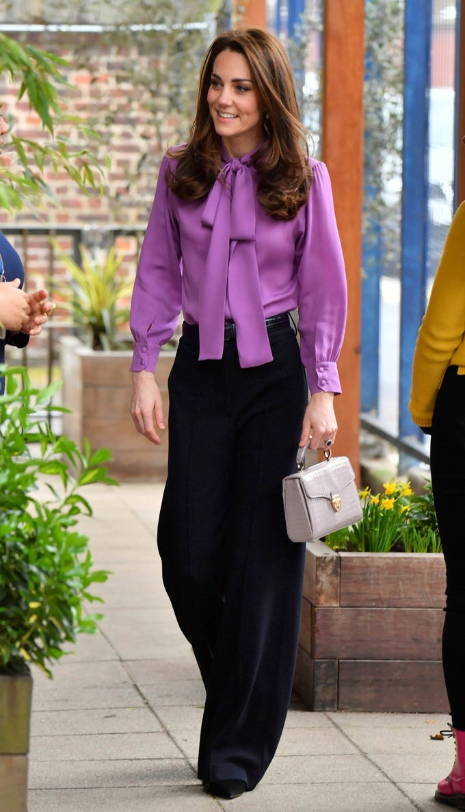 Britain's Kate the Duchess of Cambridge arrives to visit the Henry Fawcett Children's Centre in Kennington, London, Tuesday March 12, 2019. (Arthur Edwards/Pool Photo via AP) ORG XMIT: AMB102