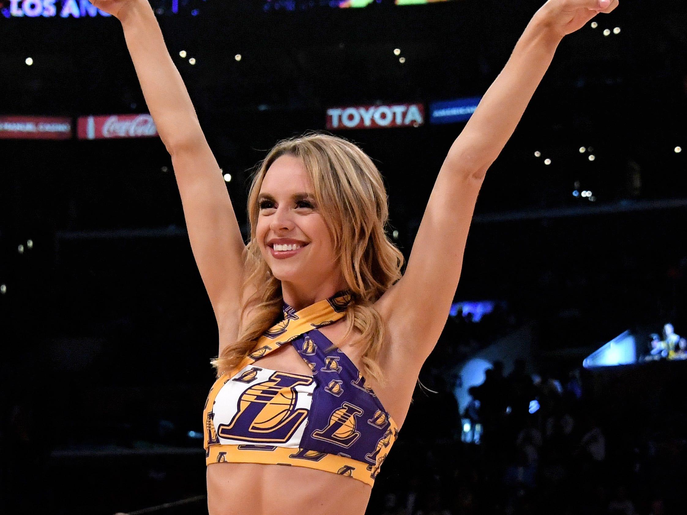 March 26: A Los Angeles Lakers dancer performs in the first half against the Washington Wizards at Staples Center.