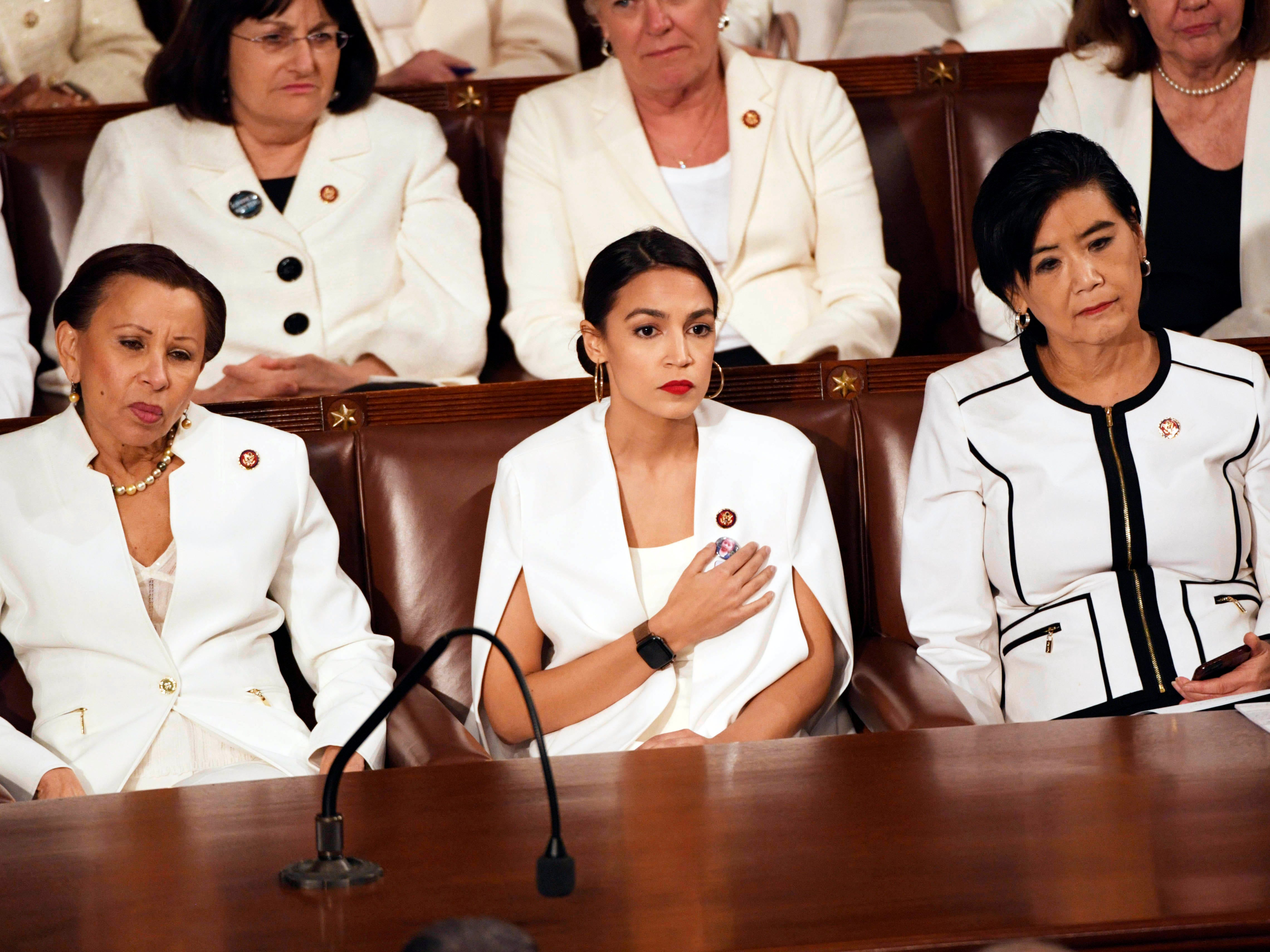 Feb 5, 2019; Washington, DC, USA; Rep. Alexandria Ocasio-Cortez (D-N.Y.) and other Congresswomen wear white as they listen as President Donald Trump delivers the State of the Union address from the House chamber of the United States Capitol in Washington.  Mandatory Credit: Jasper Colt-USA TODAY NETWORK ORIG FILE ID:  20190205_sal_usa_5267.JPG