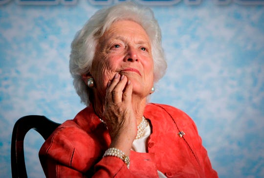In this file photo from Friday, March 18, 2005, former first lady Barbara Bush listens to her son, President George W. Bush, as he speaks on Social Security reform in Orlando, Fla.