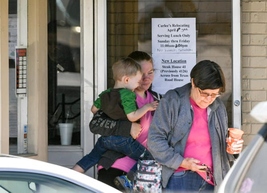Customers leave after lunch Thursday at Carlee's and Tony's On Main in Anderson Thursday.