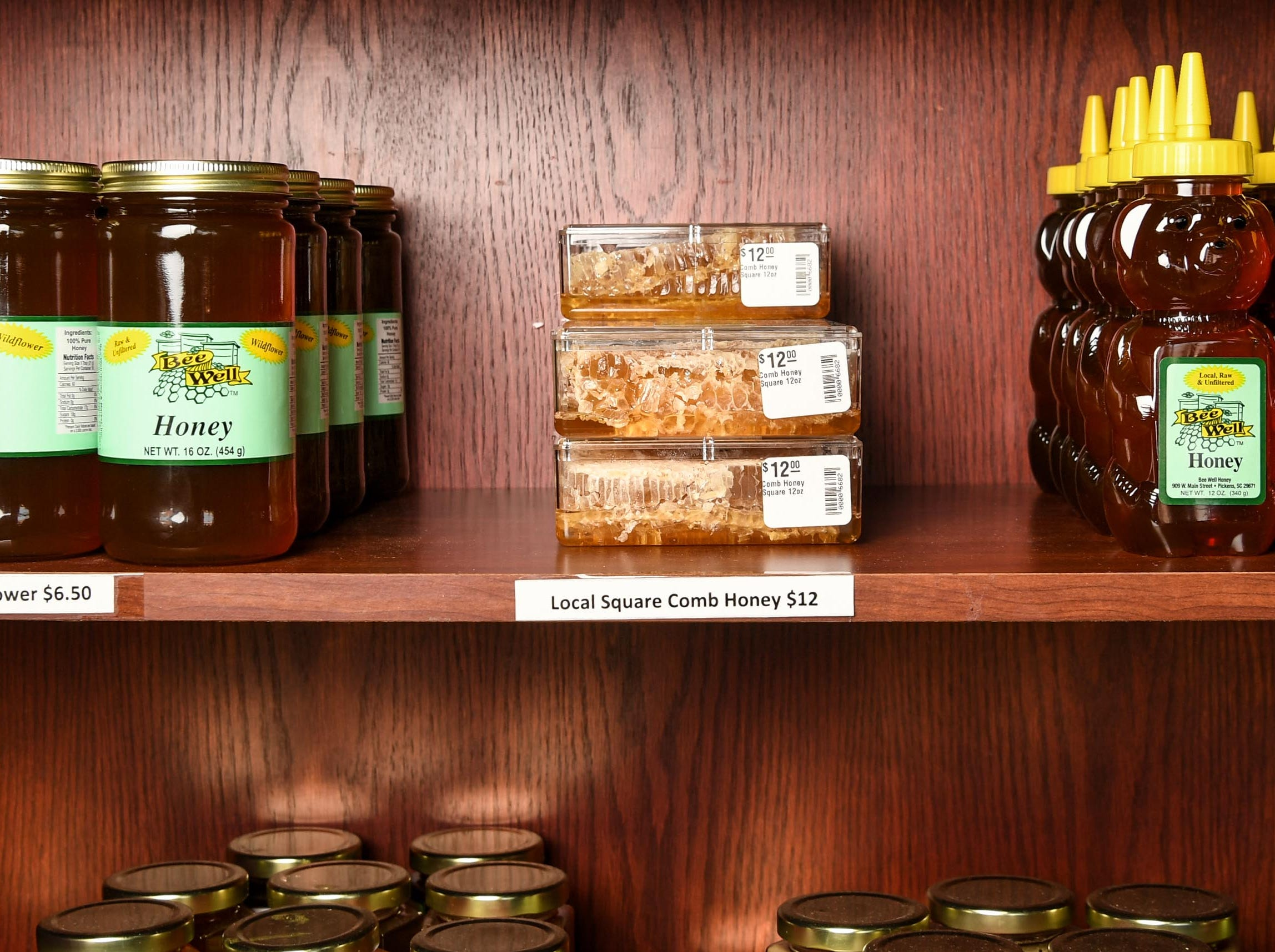 A shelf of Bee Well Honey products for sale at a store in downtown Pickens Thursday.