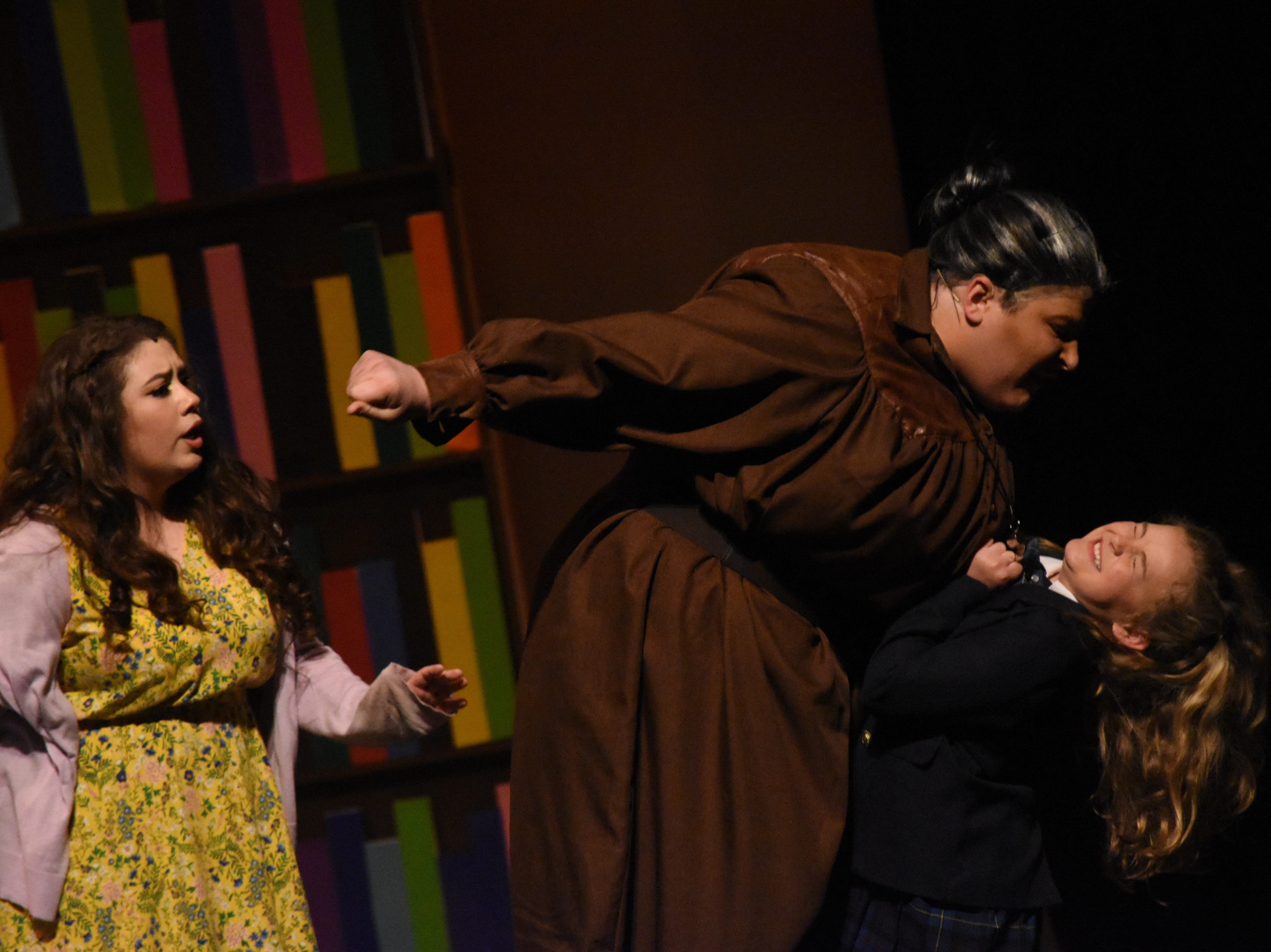 """Evie LaFleur (right) stars as Matilda, Brady Sanders as the evil school headmistress Miss Trunchbull and Lesley Brunk as Matilda's kind teacher Miss Honey in Lagniappe Theatre Company's presentation of """"Matilda the Musical"""" based on the book by Roald Dahl. The show begins at 7 p.m. Thursday, Friday and Saturday and at 2:30 p.m. Sunday at the Coughlin-Saunders Performing Arts Center in downtown Alexandria. Also starring as Matilda is Chloe Lair. """"Matilda the Musical"""" is the story of an intelligent young girl who is born into an unloving family. She is sent away to school where her kind schoolteacher is impressed with her. The school's headmistress, however, doesn't like children doles out cruel punishments for those who break her rules."""