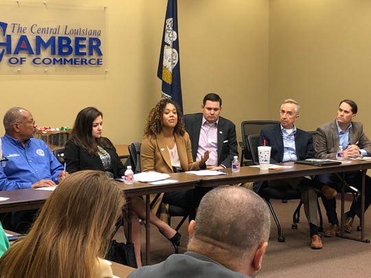 Lauren Alexander (right), policy communications manager for Lyft, talks about the ride-sharing company Thursday at the Central Louisiana Regional Chamber of Commerce. She and Evangeline George (left), Uber's Southeast public affairs manager, were there to speak about legislation that could allow the companies to operate throughout Louisiana.