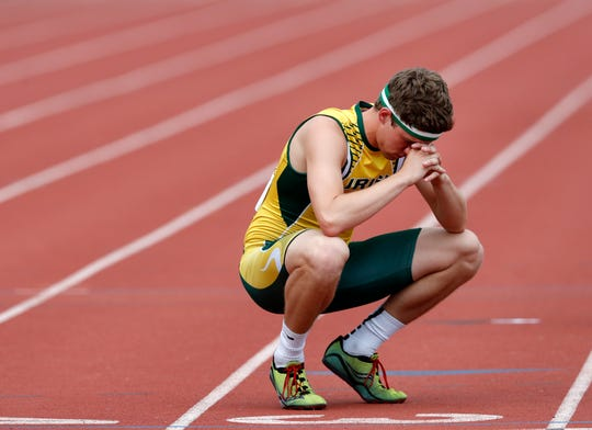 Freedom's Devin Baumgart takes a moment on the track before the start of the 1,600-meter relay in 2017 in La Crosse.