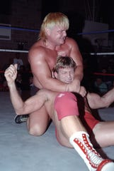 """Greg """"The Hammer"""" Valentine and Paul Orndorff in a vintage still seen in the documentary """"350 Days."""""""