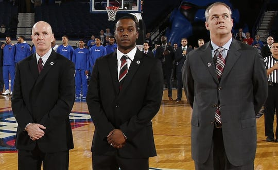 Jay Young (left) stands with Brandin Knight and Steve Pikiell prior to a Rutgers basketball game.