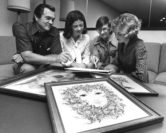 From left, auctioneer Rocky Ash, Jo Ann Wilson and Elayne Weeks watch artist Clint Hamilton, second from right, sketch props to be used to decorate an Abilene Fine Arts Museum auction.