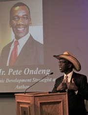 Wearing his new cowboy hat, Kenyan Pete Ondeng expresses his thoughts during last week's induction in Hardin-Simmmons University's Hall of Leaders. He is a 1982 graduate with a Bachelor of Business Administration degree.