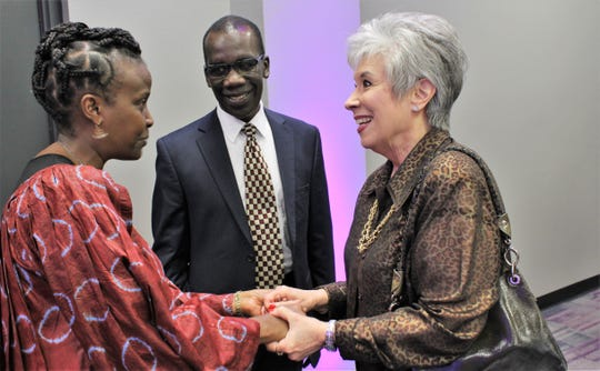 Pete Ondeng's wife May, left, meets former Hardin-Simmons first lady Carol Hall after last week's Hall of Leaders ceremony on campus.