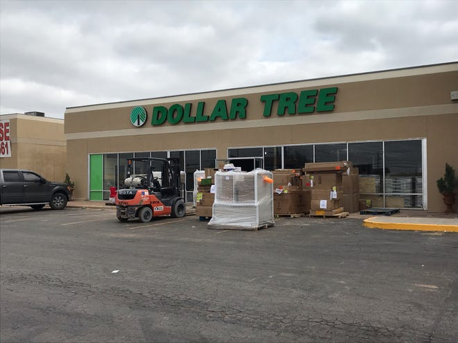 Supplies sits outside a new Dollar Tree on South 14th Street next to Mardels on  Thursday, March 28, 2019.