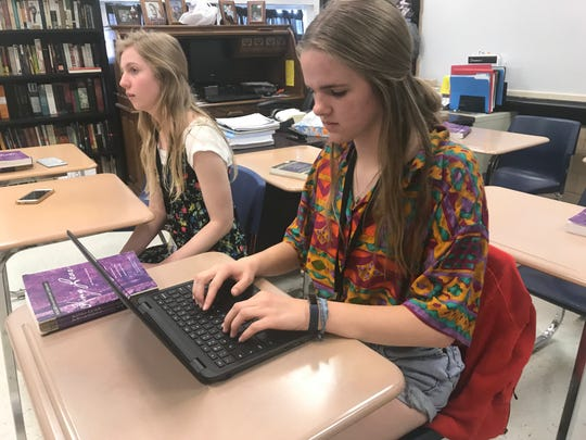 Abigail Griffith (right), a senior at Abilene High School, prepares correspondence with a museum curator in Wyoming ahead of finishing her Advanced Placement Research project Wednesday. Griffith is one of 12 students, also including Samantha McMillan, left, who will take their research to Abilene Christian University for the 2019 Undergraduate Research Fair before defending their work later this spring.