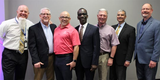 A motley crew for sure. Hall of Leaders honoree Pete Ondeng, center, is flanked by his Tau Alpha Phi fraternity brothers, from left, Greg Jaklewicz, Phil Ashby, Paul Gomez (an Abilene High grad), Jim Whitlock, Alex Vasquez (an Abilene High grad) and Clark Baker. All came to honor Ondeng at his induction March 22 at Hardin-Simmons University.