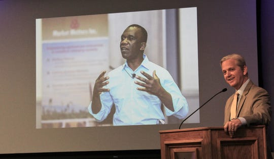 Hardin-Simmons president Eric Bruntmyer introduced Hall of Leaders inductee Pete Ondeng, pictured on screen, on March 22.