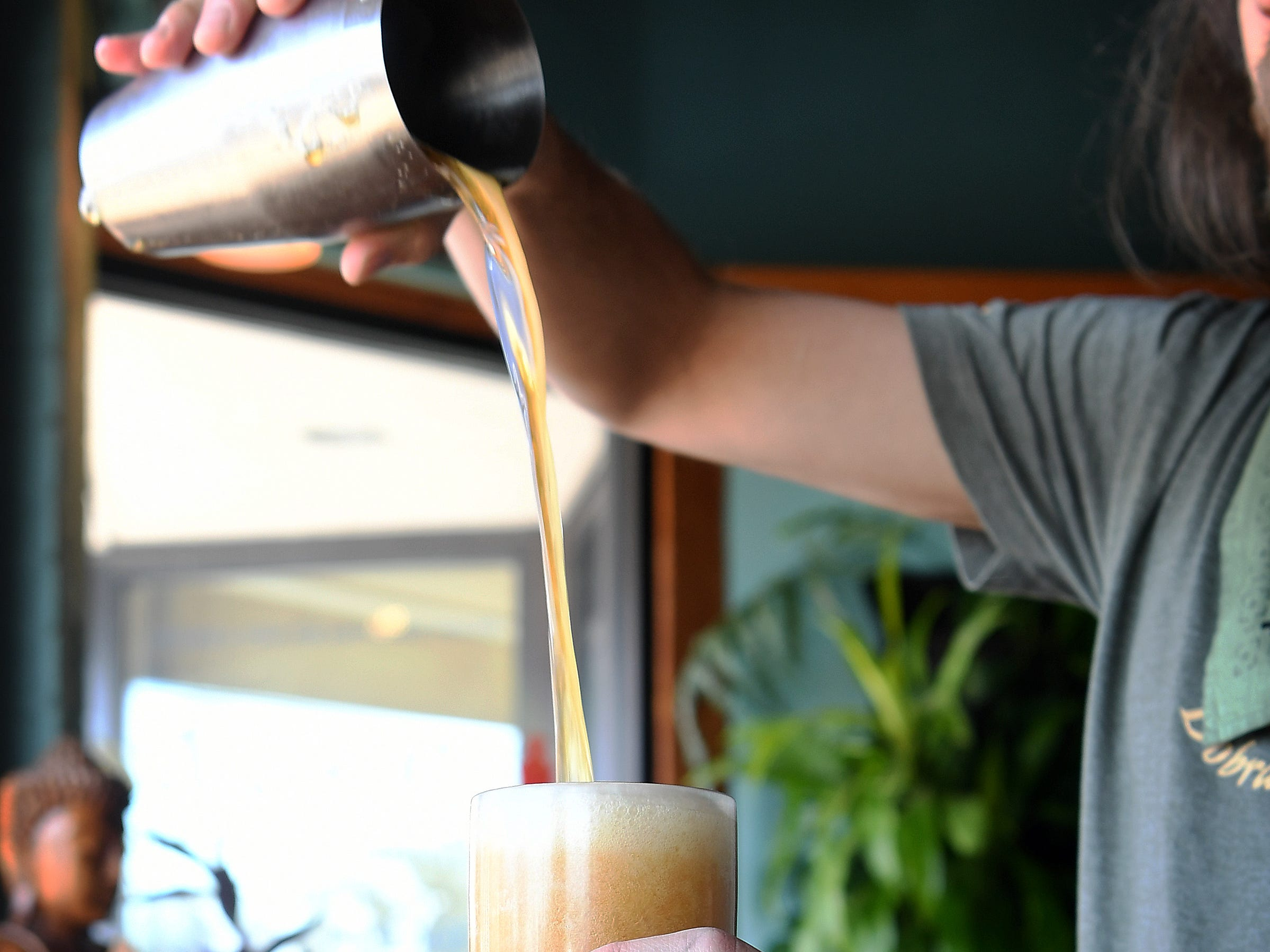 Staroborshov tea, served at Dobra Tea's West Asheville location, is a dark oolong tea shaken with some organic sugar to produce a frothy head that looks similar to a beer.