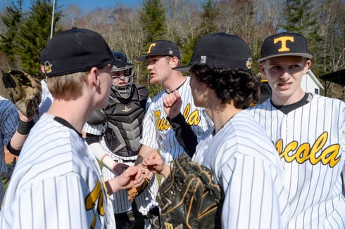 Landon Henley, center, gives his team a pep talk before heading to the pitcher's mound during the game against Asheville March 27, 2019, in Waynesville.