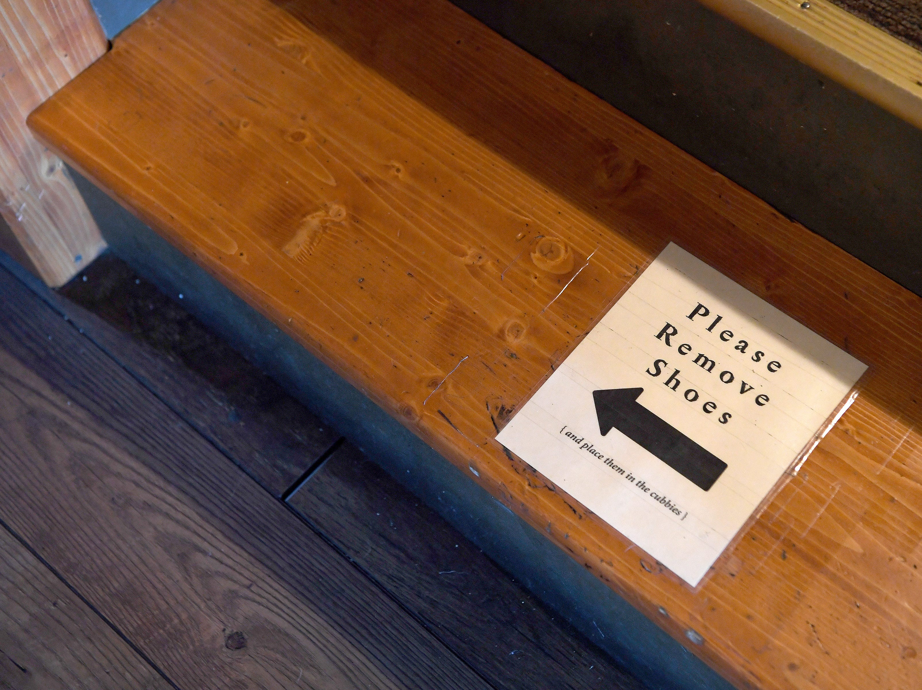 An area of Dobra Tea's West Asheville location requires the removal of shoes for raised floor seating.