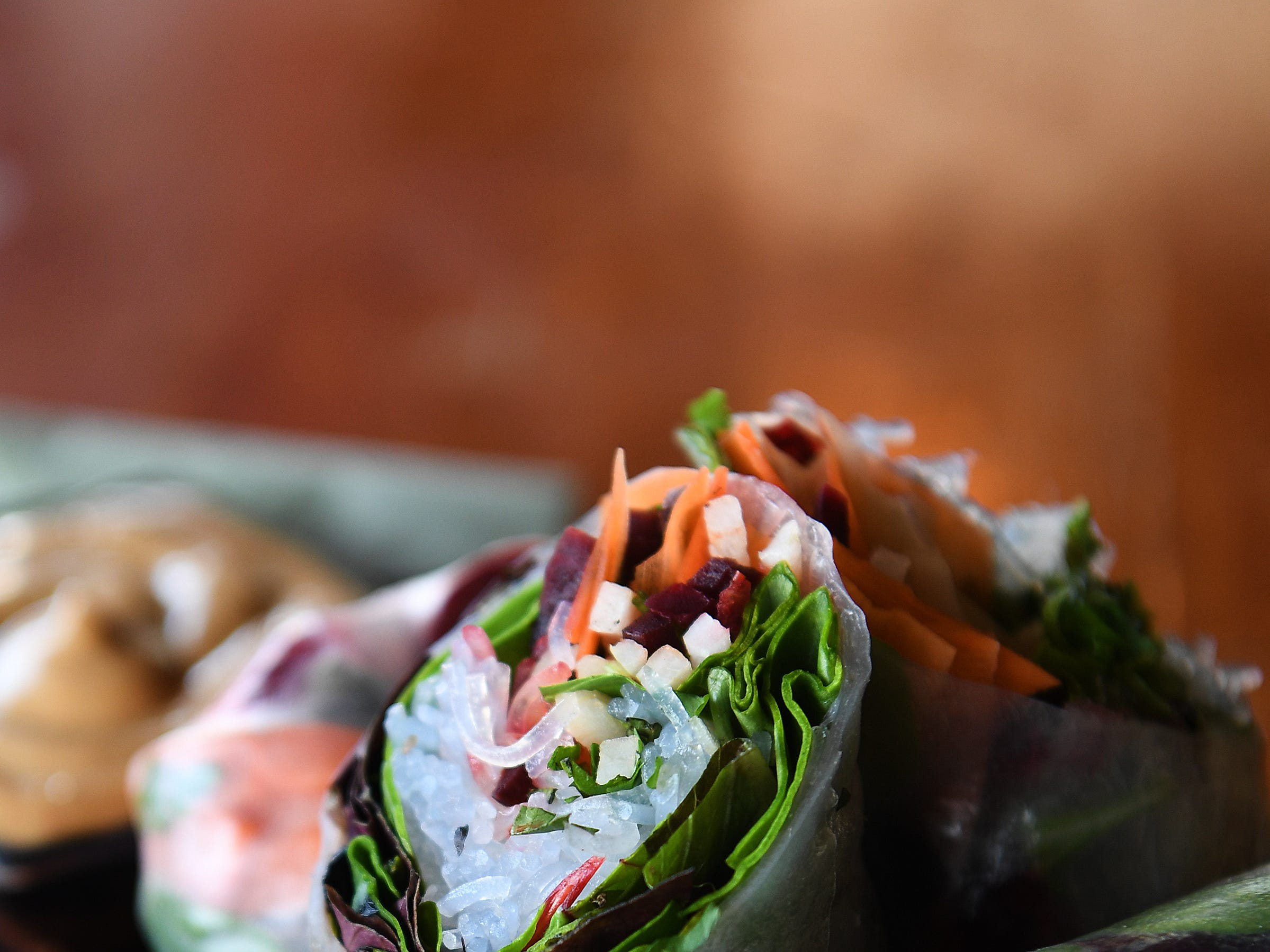The spring rolls at Dobra Tea's West Asheville location are carrot, beet and daikon wrapped in rice paper with mung bean noodles, fresh mint and cilantro served with peanut sauce.