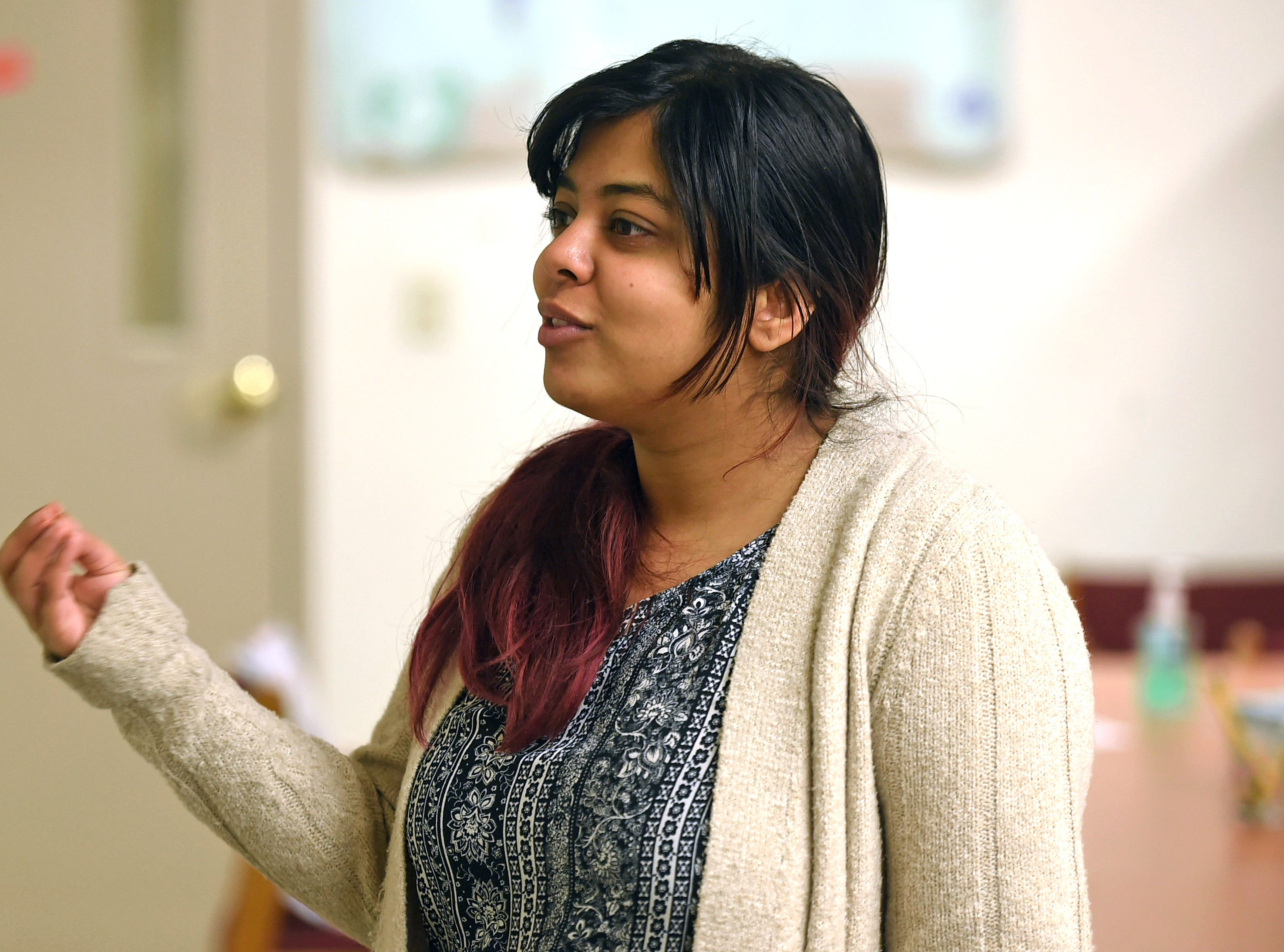 Renelle Pereira, a Binghamton University graduate, volunteers at The American Civic Association in Binghamton. Pereira, who recently became an American citizen, is a co-leader of the ACA's newly formed Girl Scout troop.