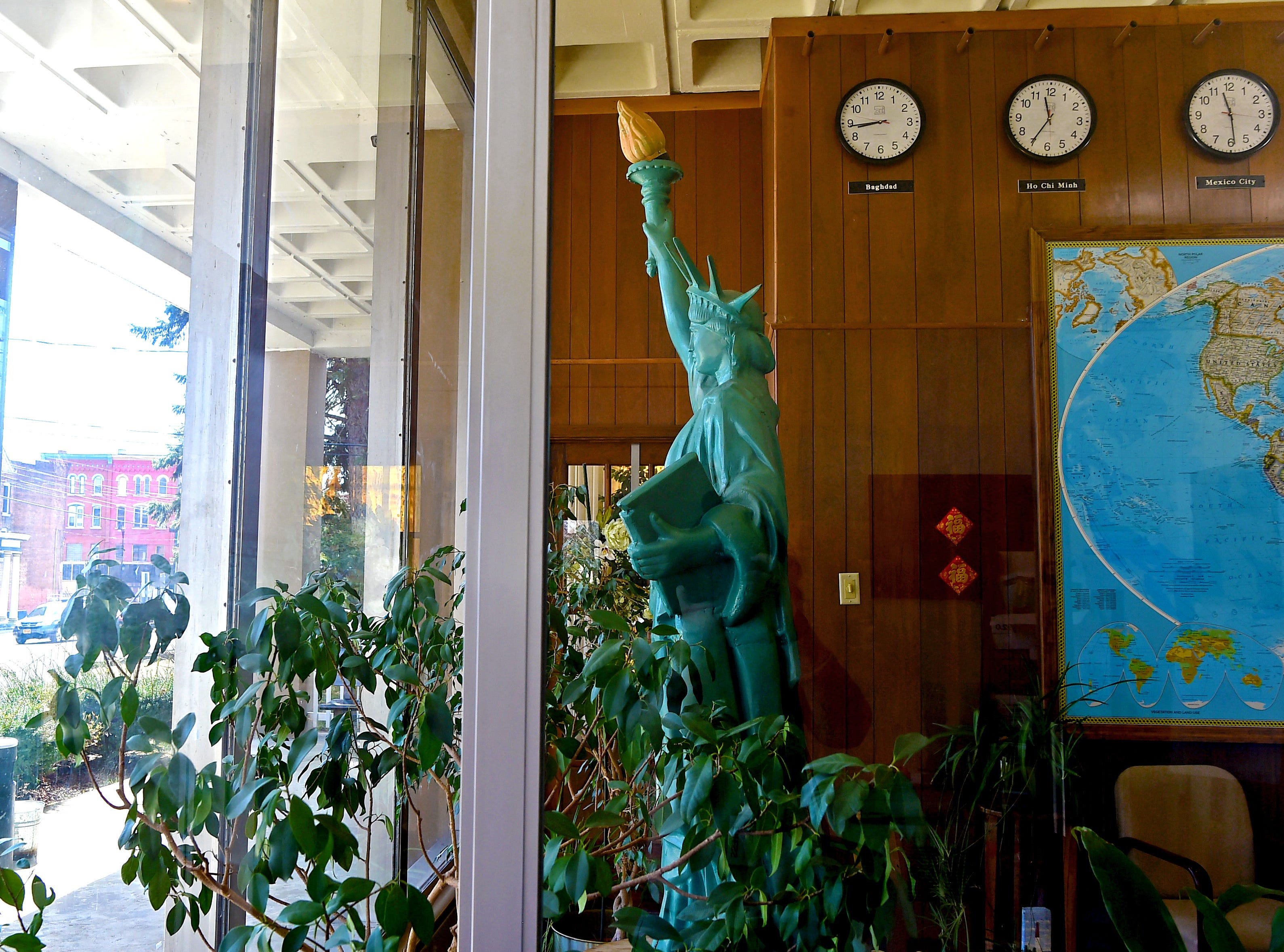 A Statue of Liberty replica welcomes visitors to the American Civic Association in Binghamton. The organization helps immigrants and refugees assimilate into society and guides them in becoming U.S. citizens.
