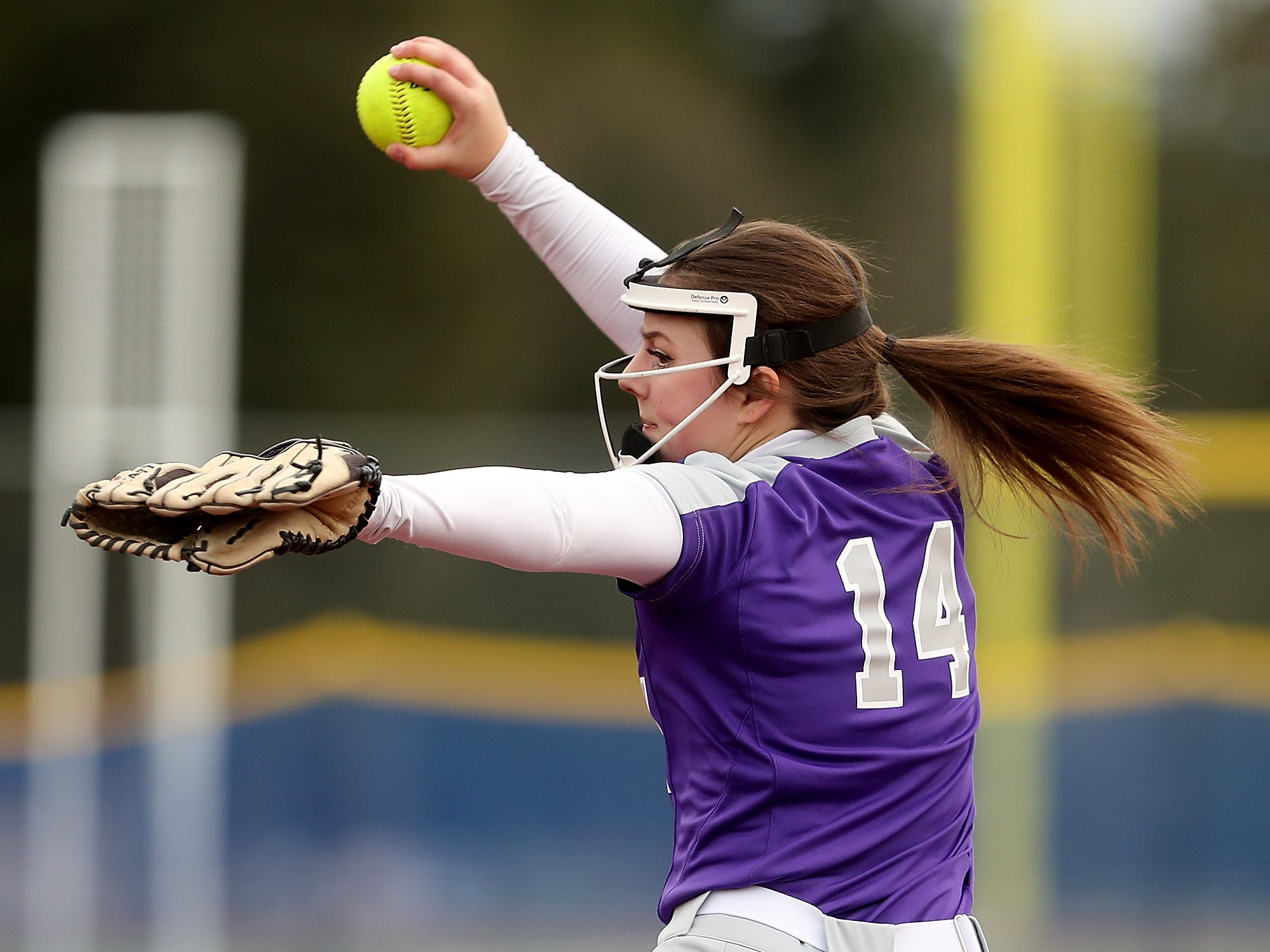 North Kitsap's Sarah Smith pitches against Olympic at Gene Lobe Field on Wednesday, March 27, 2019.