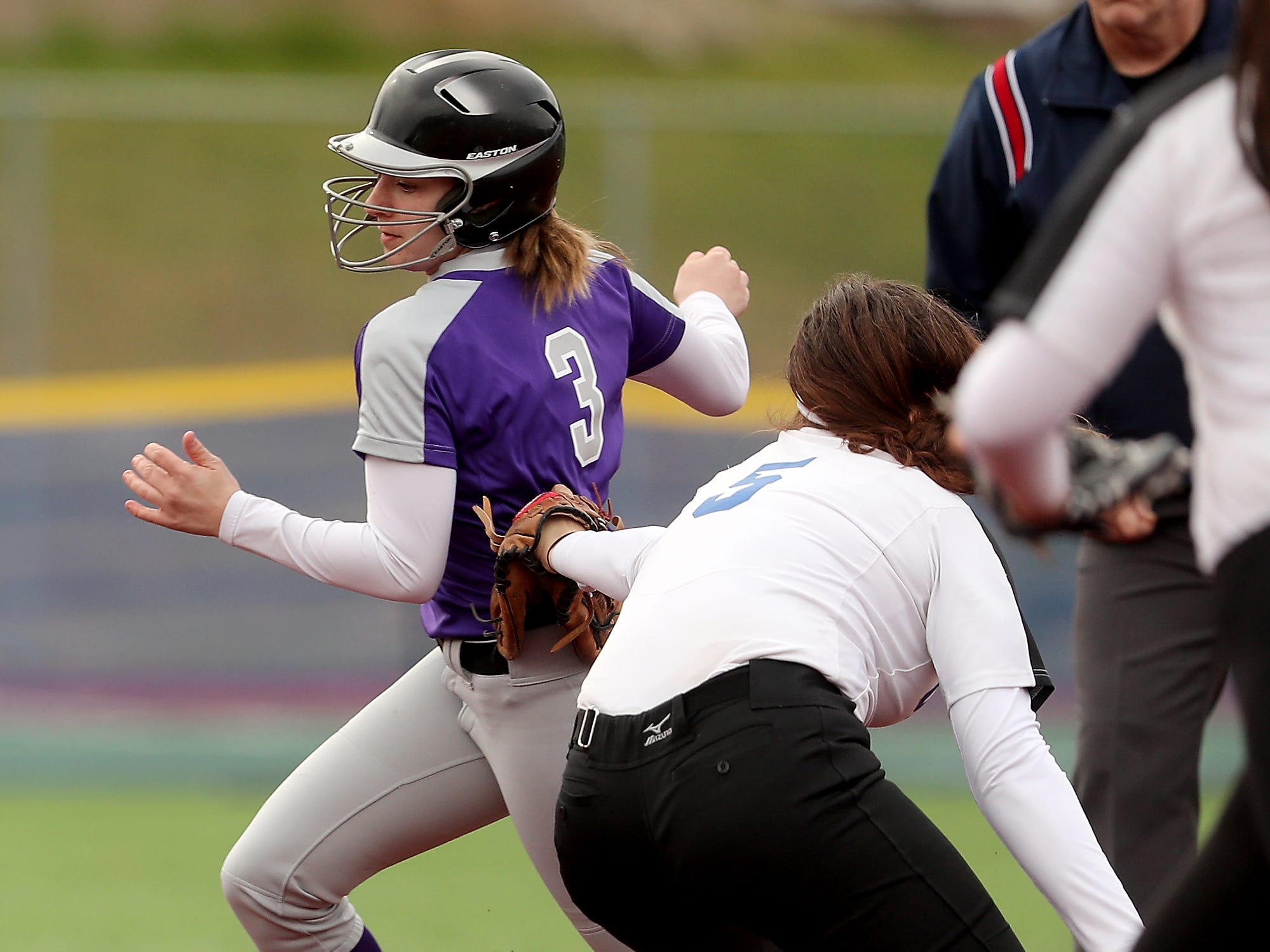 North Kitsap's Olivia Holmbery (3) is tagged out by Olympic's Vanisa Ivie at Gene Lobe Field on Wednesday, March 27, 2019. Holmbery was tagged out by Ivie.