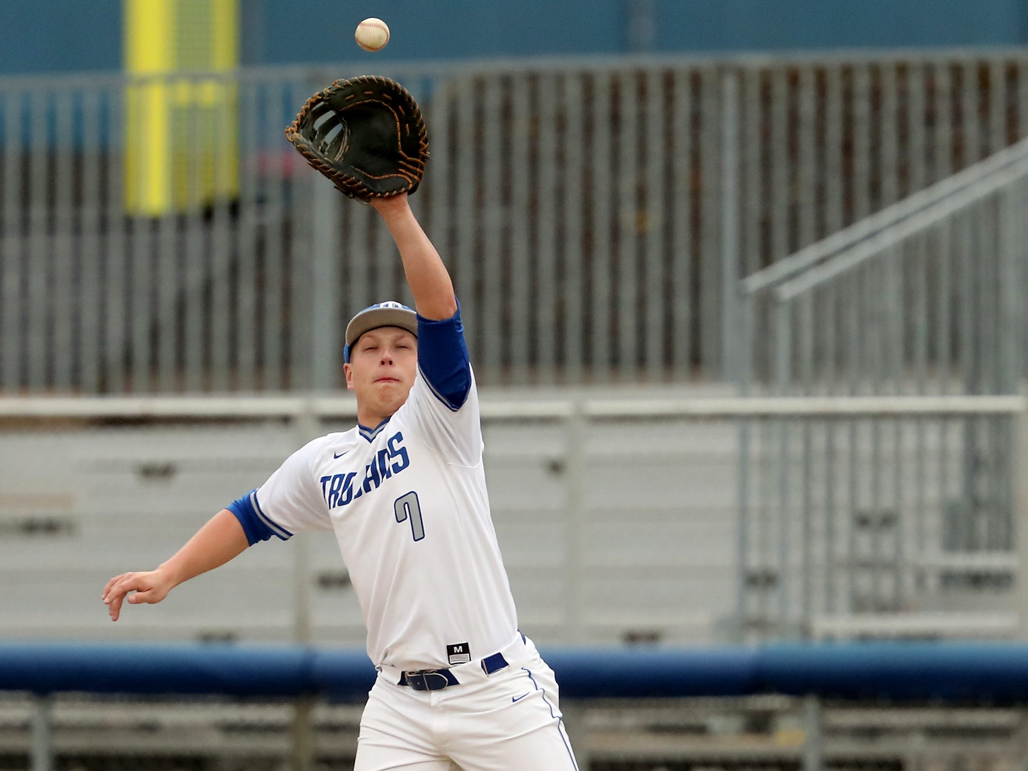 Olympic's Dylan Heino makes a catch at first for an out against North Kitsap Baseball at Gene Lobe Field on Wednesday, March 27, 2019.
