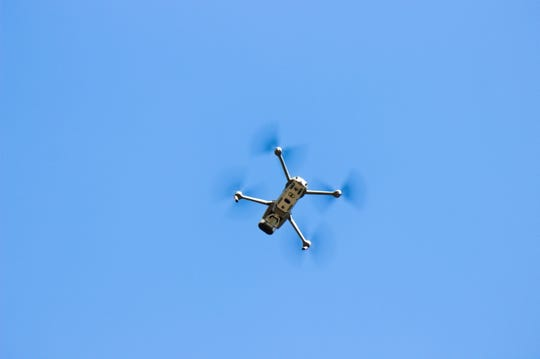 The Poulsbo Police Department's drone soars above a parking lot during a demonstration flight.