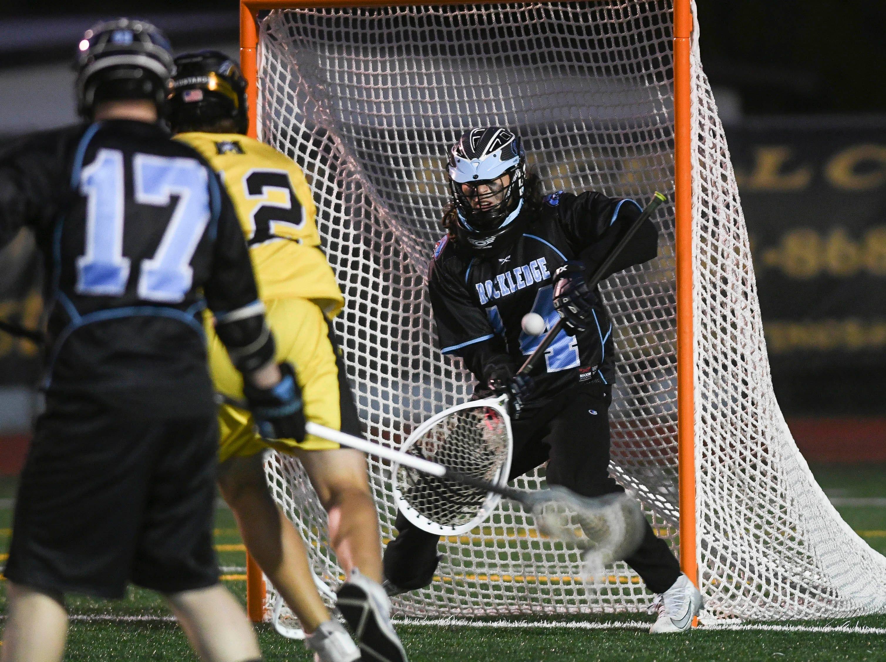 Rockledge goalkeeper Luke Reed stops a shot by Davin Stephenson of Merritt Island during Wednesday's game.