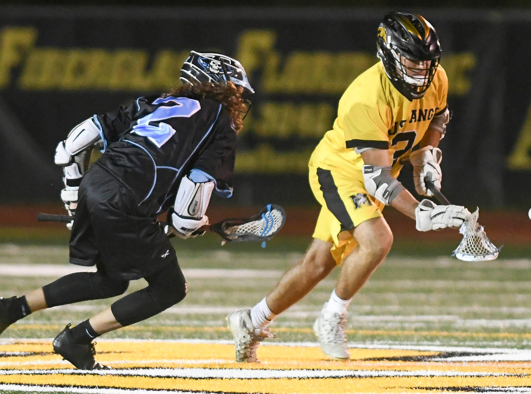 Cade Madonna of Rockledge and Nick Sidor of Merritt Island chase the ball during Wednesday's game.