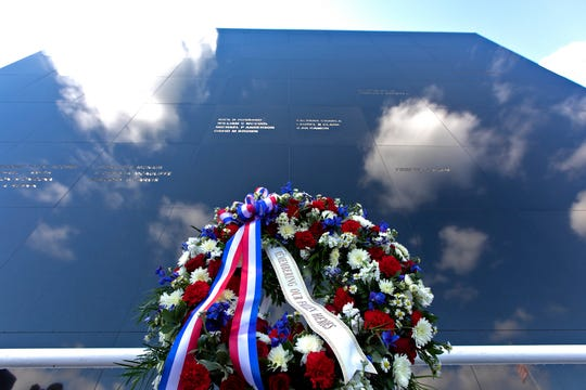 A memorial wreath stands before the Space Mirror Memorial at the Kennedy Space Center Visitor Complex during NASA's annual Day of Remembrance ceremony on Feb. 7, 2019. The memorial, a 42-foot-high by 50-foot-wide granite monument, displays the names of the fallen astronauts from Apollo 1, space shuttles Challenger and Columbia, as well as others who have lost their lives while on NASA missions or in training. Each year, Kennedy employees and guests gather with others throughout NASA to honor those astronauts who have fallen in the pursuit of space exploration.