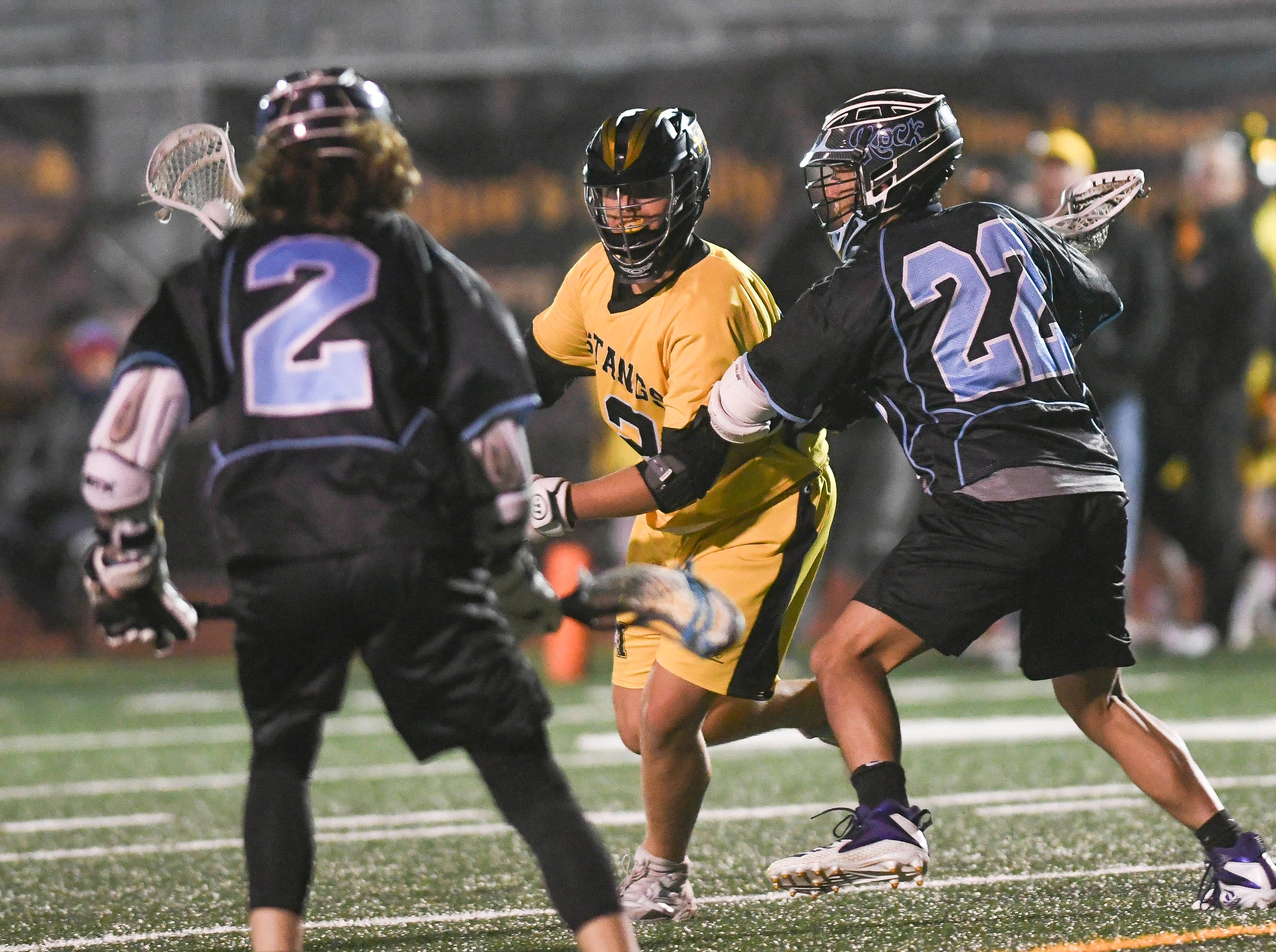 Gavin Stephenson of Merritt Island is guarded by Cade Madonna (2) and Tyler Figueroa of Rockledge during Wednesday's game.