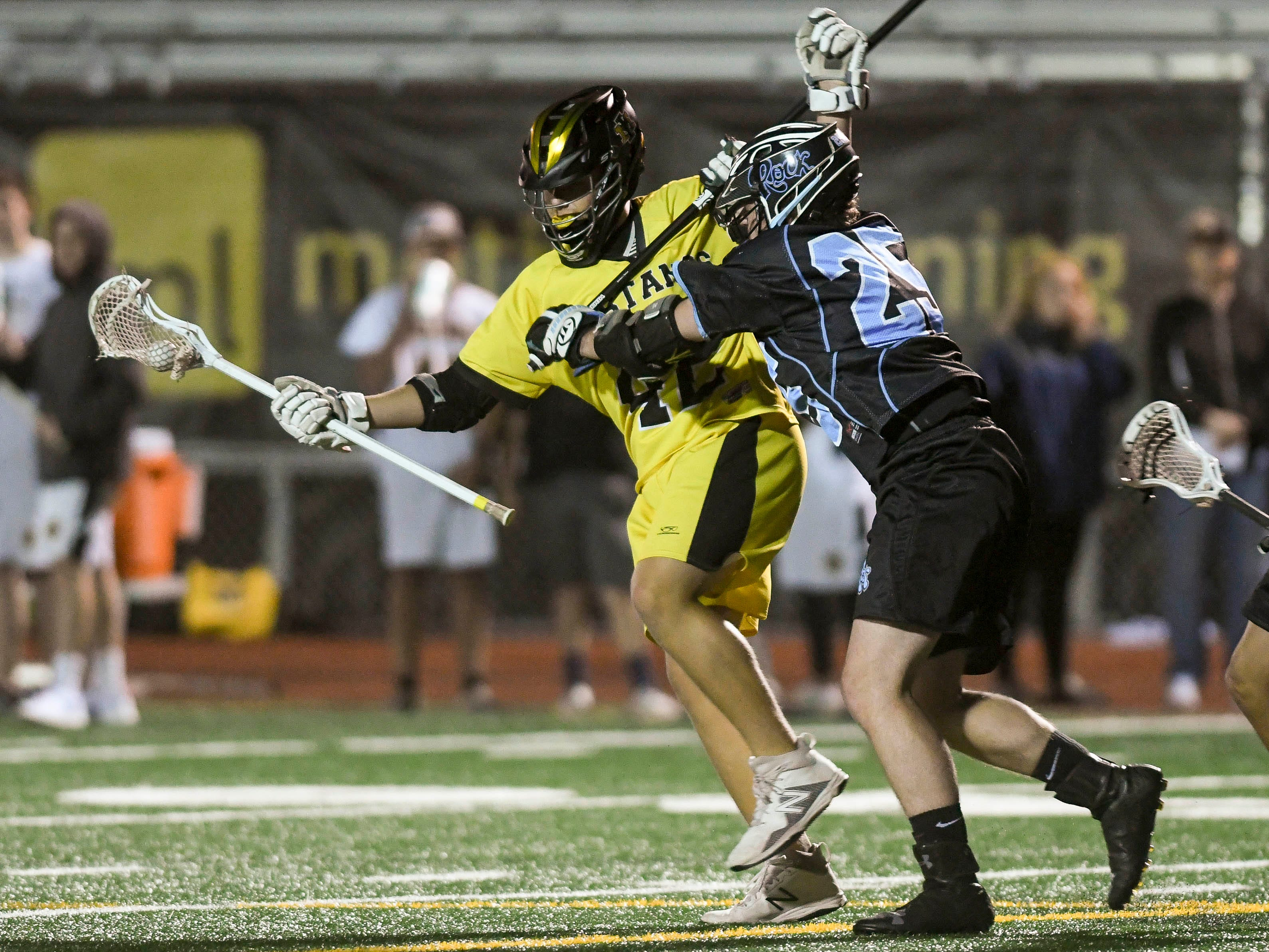 Gavin Stephenson of Merritt Island is checked by Eli Compton of Rockledge during Wednesday's game.