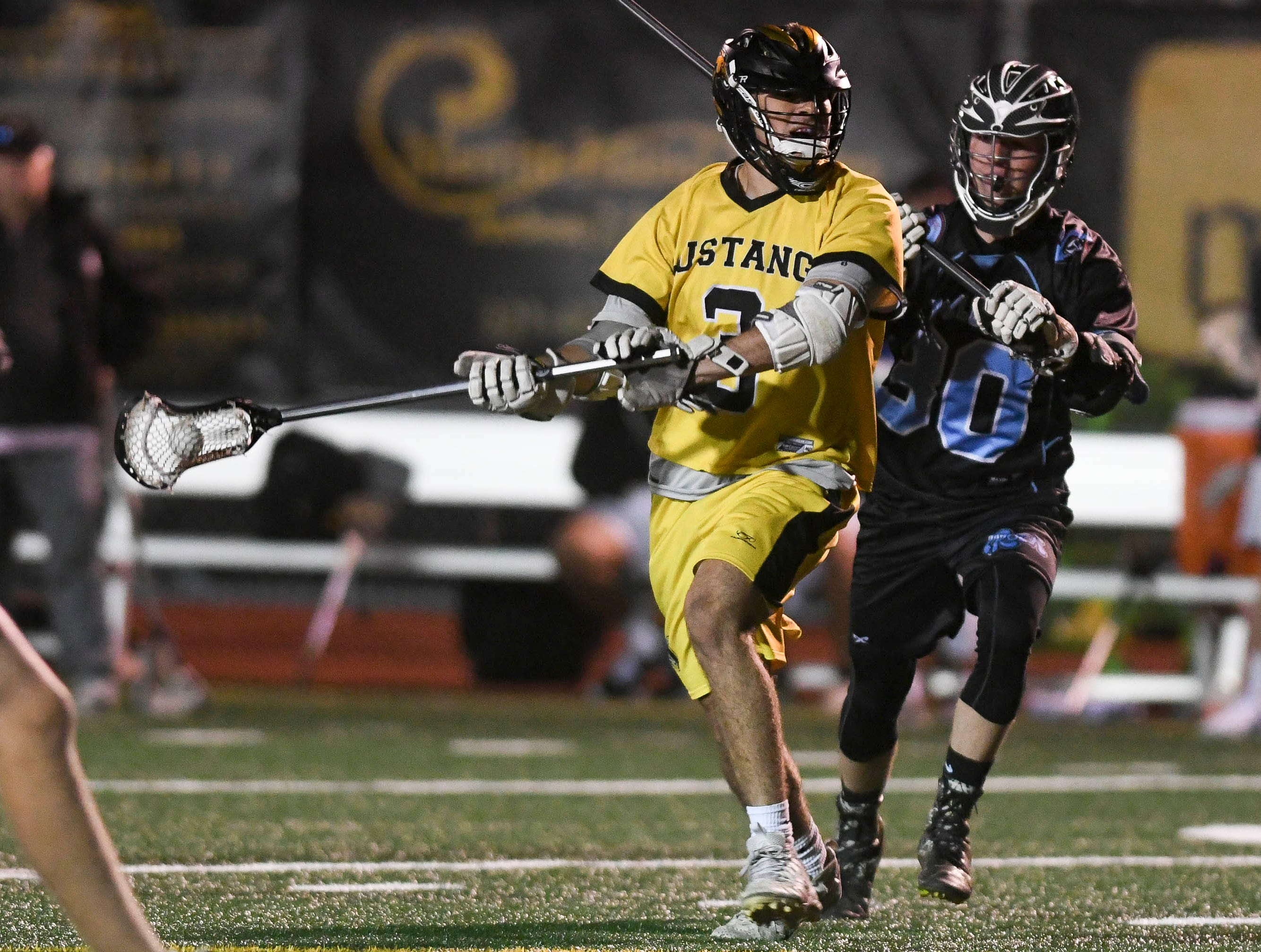 Nick Sidor of Merritt Island is pursued by Andy DelCampo of Rockledge during Wednesday's game.
