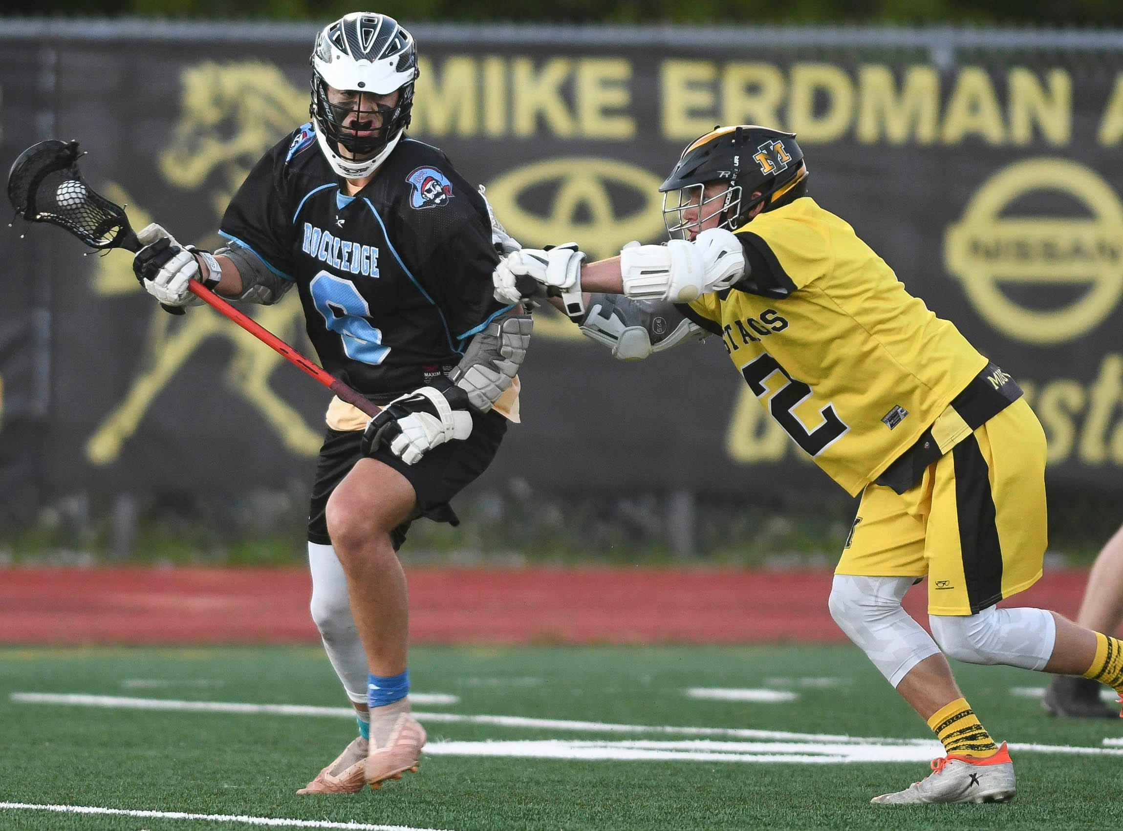 Alex Rahal of Rockledge is pursued by Sean Druck of Merritt Island during Wednesday's game.