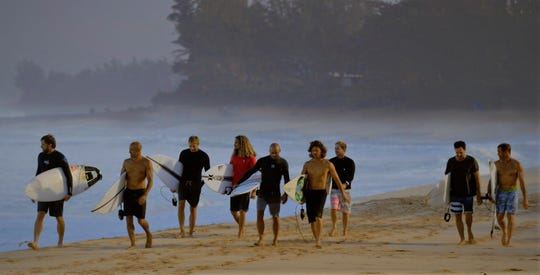 "Cocoa Beach's Kelly Slater, center in black wetsuit, is among the stars in HBO's ""Momentum Generation."""